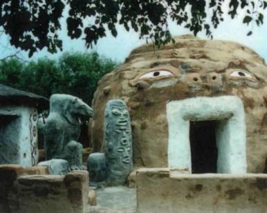 hut and sculpture