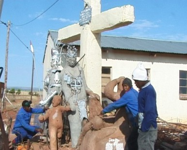 Students showing sculpture