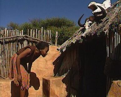 woman entering hut
